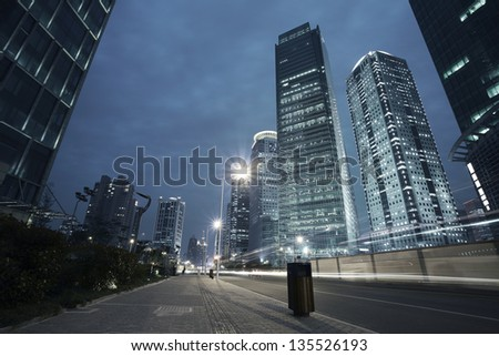 Bottom angle shooting highway car light trails of modern urban buildings #135526193