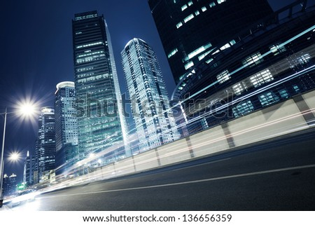 Bottom angle shooting highway car light trails of modern urban buildings   #136656359