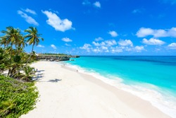 Bottom Bay, Barbados - Paradise beach on the Caribbean island of Barbados. Tropical coast with palms hanging over turquoise sea. Panoramic photo of beautiful landscape.