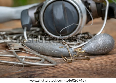 Bottom fishing accessories, sinkers and hooks on wooden background #1460209487