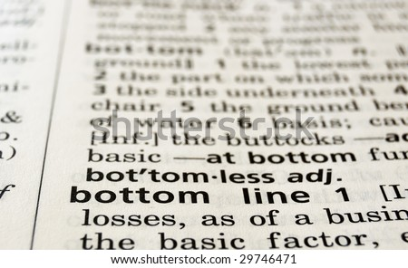 Bottom Line in a dictionary, closeup