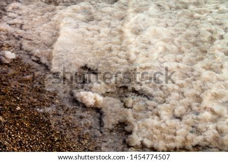 Bottom of dead sea with strange pictures of salt crystalls