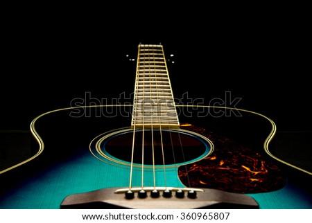 bottom of guitar on black