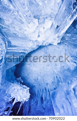Bottom-up view of blue icicles. Freezing atmosphere