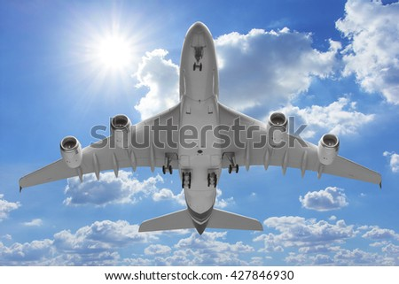 Bottom view airplane takeoff to the sky #427846930