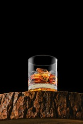 Bottom view at the glass with single malt whiskey with ice