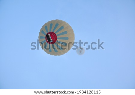 Bottom view of beautiful hot air balloons flying against the blue sky over Cappadocia in the early morning