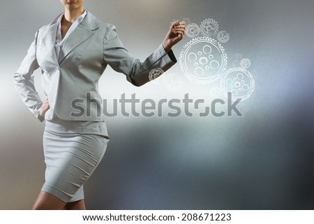 Bottom view of businesswoman drawing business sketches