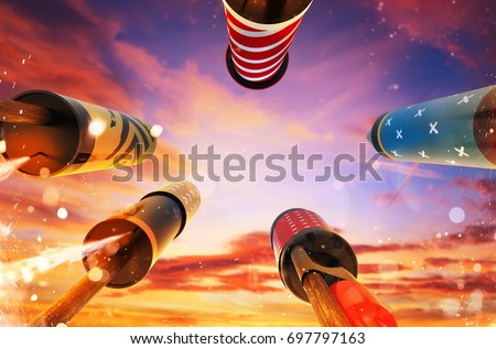 Bottom view of fireworks rockets launching into the sky, free space for text. Concept of celebration and New Years Eve. 3D render of rockets. #697797163