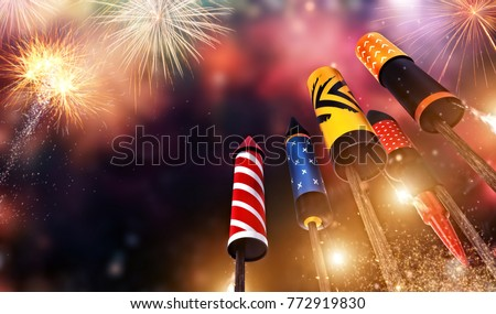 Bottom view of fireworks rockets launching into the sky, free space for text. Concept of celebration and New Years Eve. 3D render of rockets. #772919830