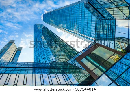 Bottom view of modern skyscrapers in business district against blue sky #309144014