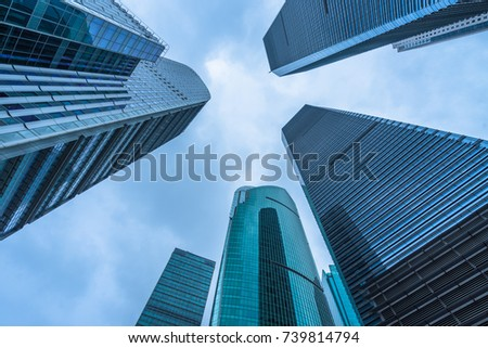Bottom view of modern skyscrapers in business district against blue sky #739814794