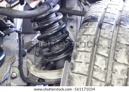 Shutterstock bottom view of the chassis raised on a lift car