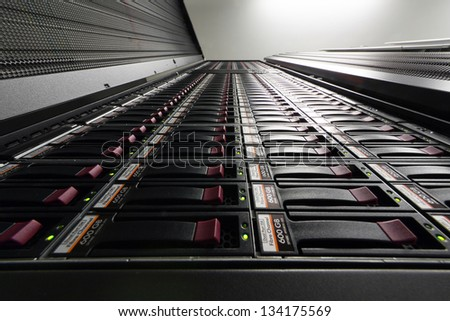 Bottom view on big rack with multiple hard drives.