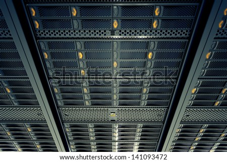 Bottom view on data servers while working. Blue LED lights are flashing. Image can represent cloud computing, information storage, etc. or can be the perfect technology background. Foto stock ©