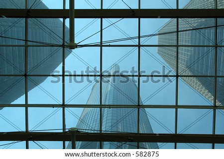 Bottom view on skyscrapers through the glass roof