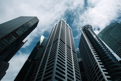 Bottom view to modern skyscrapers at downtown district. Business below background. Singapore city