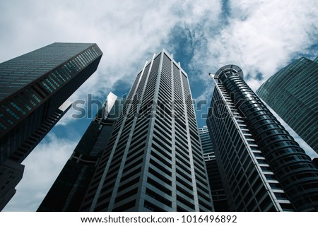 Bottom view to modern skyscrapers at downtown district. Business below background. Singapore city #1016496892
