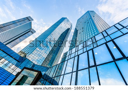 Bottom wide angle view of modern skyscrapers in business district with blue sky and clouds #188551379