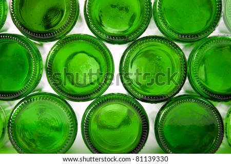 Bottoms of bottles of green. Can be used as background