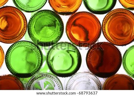 Bottoms of empty glass bottles on white