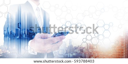 Bouble exposure businessman using smartphone with modern city in sunrise, communication network technology #593788403