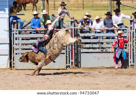 BOULDER - AUGUST 27th: unidentified cowboy rides in the bareback bull-riding competition at Jefferson County Fair and Rodeo on august 27, 2011 in Boulder, Montana