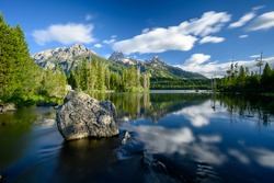 Boulder in Taggart Lake with Smeared Clouds in Grand Teton National Park