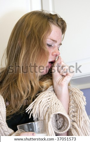 BOULDER - SEPT 14: A 15-year old girl coughs as she tries to recover from Tamiflu on September 14, 2009 in Boulder. The child is trying to recover from Influenza A subtype, H1N1. - stock photo