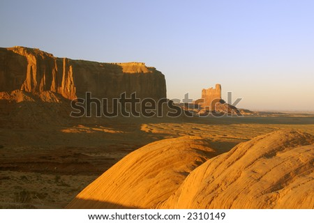 Boulders and mesas lit by the setting sun in Monument Valley, Navajo Nation.