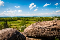 Boulders and view of battlefields on Little Round Top, in Gettysburg, Pennsylvania.