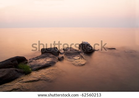 Boulders on the coastal sunset (long exposure)