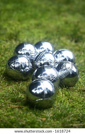 Boules on an open grass field