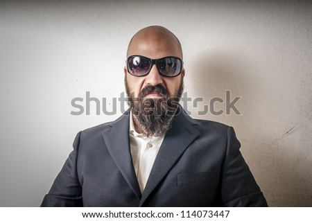 bouncer with jacket and sunglasses on white background - stock photo
