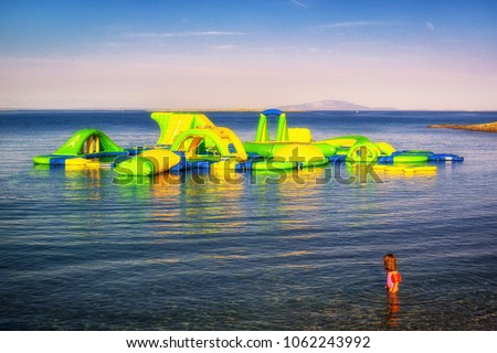 Bouncy Castle On Blue Sea Background