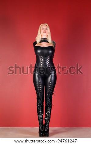 Bound Dominatrix In Black Leather Catsuit