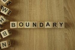 Boundary word from wooden blocks on desk