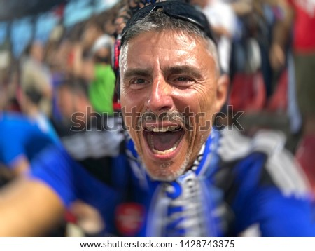 Boundless happiness of male supporter in the stadium after a final decisive goal of his supported team