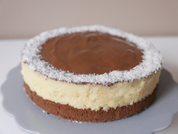 Bounty Cake with chocolate, desiccated coconut and sponge cake on the gray epergne