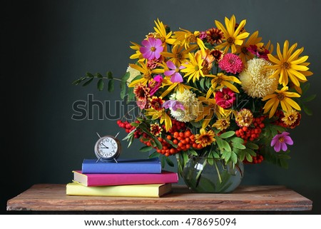 Bouquet and book. Back to school. September 1, knowledge Day. The teacher\'s day.