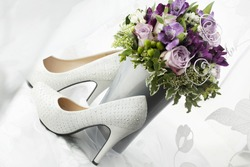 Bouquet and wedding shoes bride.