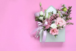 Bouquet as a gift for the holiday of March 8, St. Valentine's Day, mother's day, birthday, wedding day. Floral arrangement of tulips, eustoma, ranunculus, orchids, chrysanthemums, eucalyptus branches.