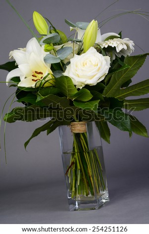 bouquet bunch of beautiful white flowers with white roses, lily and daisy