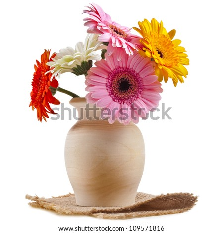 Bouquet flowers gerbera in a wooden vase on a white background