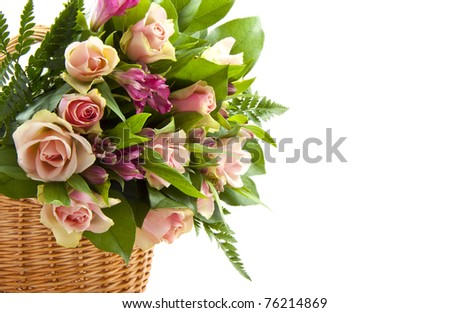 Bouquet flowers in a basket isolated over white