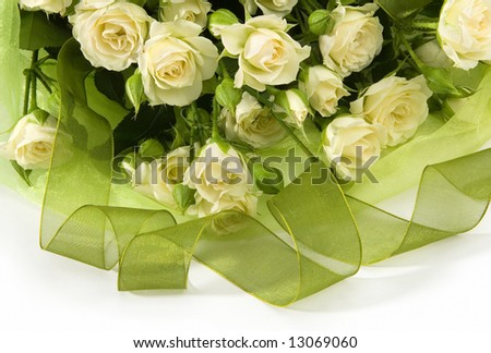 bouquet from beautiful beige roses with green tape