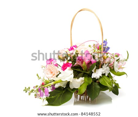 Bouquet from different pink seasonal flowers of september in basket isolated on white