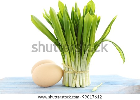 Bouquet from fresh ramson with the eggs - stock photo