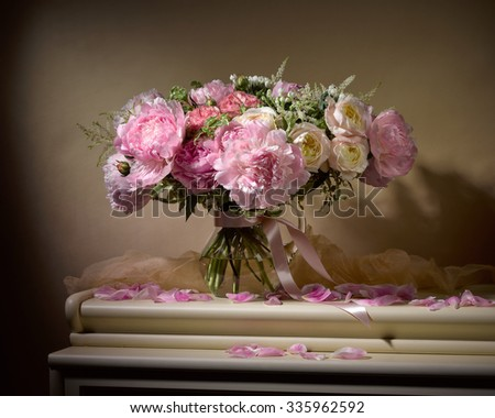 bouquet from peonies on table on beige background #335962592