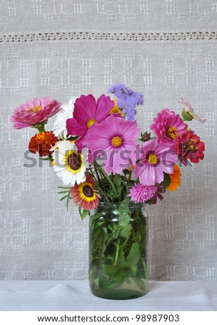 Bouquet garden flowers on the background of an old linen canvas. August, the Central Russia